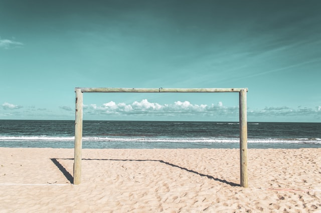This beachside soccer goal reminds us to keep the goal in mind when organizing content.