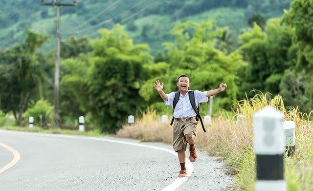 Boy running excitedly