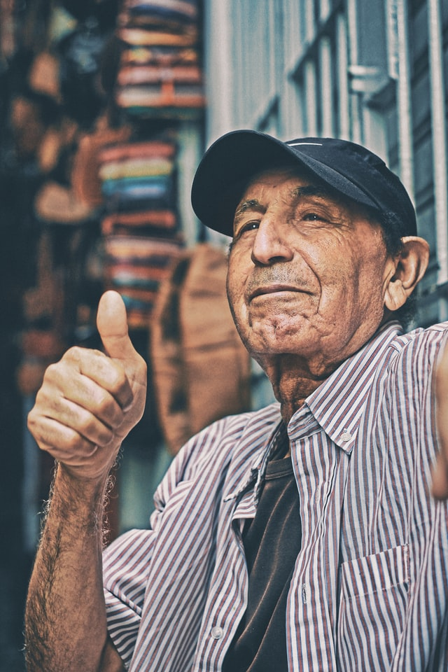 Smiling man giving thumbs-up